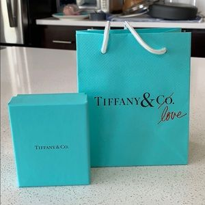 "Tiffany & Co. jewelry box and ""love"" bag"